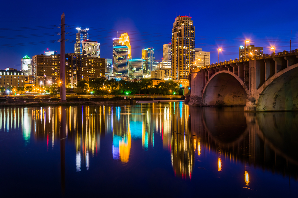 The Central Avenue Bridge and skyline reflecting in the Mississippi River at night, in Minneapolis, Minnesota.